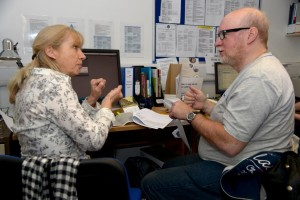 Richmond AID Advisor Suzanne signing with a deaf client Joseph