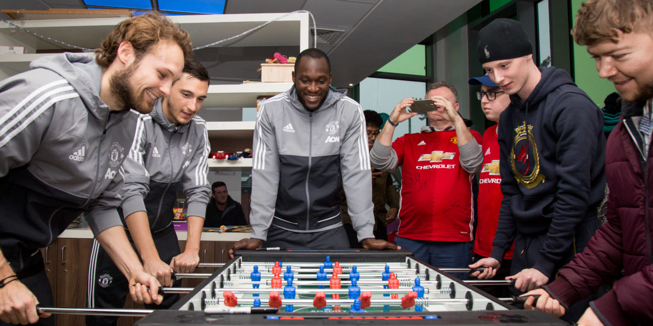Manchester United players deliver Christmas presents to local children's hospitals