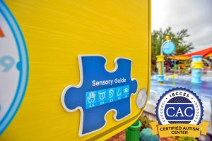 An image of a sign at SeaWorld Orlando which features a sensory guide in the shape of a jigsaw