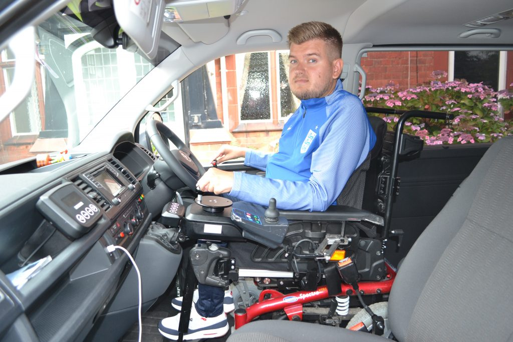 Powerchair football - Chris Gordon in Lewis Reed drive from vehicle