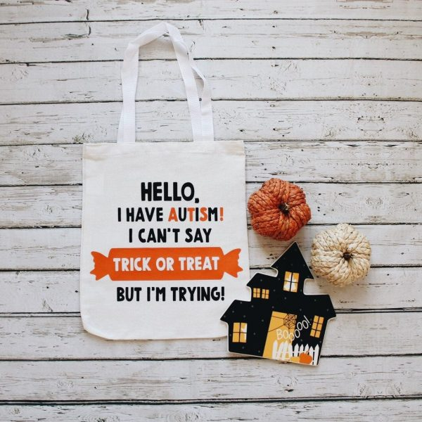 """A tote bag to take trick or treating on Halloween. The text on the bag reads """"Hello. I have autism! I cant say trick or treat, but Im trying!"""""""