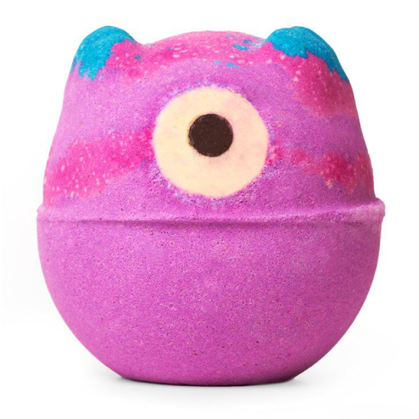 A Halloween bath bomb from Lush. It has a large beady eye and two tiny blue ears on its pink marbled body.