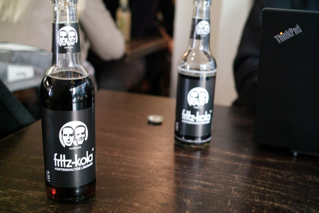 Two bottles of Fritz-Kola on a table