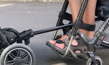 Pram attachment for wheelchair users